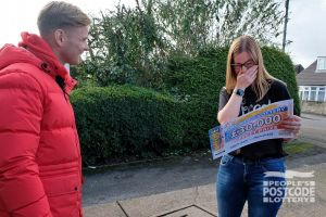 Claire was so surprised when she pulled her £30,000 cheque from its golden envelope that she burst into tears!
