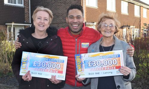 Two of our delighted Lancing winners Wendy and Carol with Street Prize Presenter Danyl