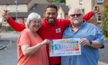 Danyl Johnson celebrating with Barry, one of our lucky Leeds winners, and his partner Joan