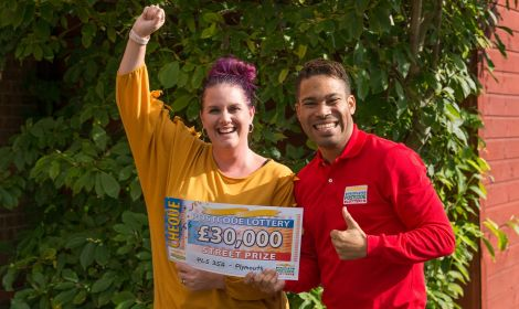 Dawn, one of our delighted Plymouth winners, with her lucky cheque and Street Prize Presenter Danyl Johnson