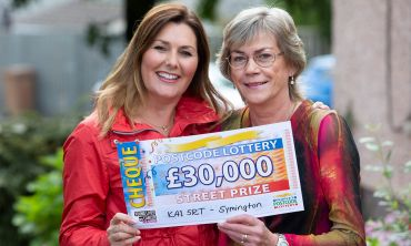 Judie with our lucky Symington winner Margaret and her £30,000 windfall