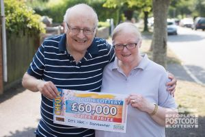 Danyl with lucky winner Heather and her husband Peter holding their £60,000 cheque