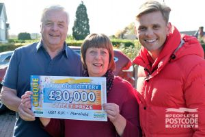 Jeff with Margaret and Ian holding their £30,000 cheque