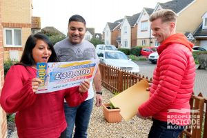Another lucky winner, Puja, with husband Rishi, collects her cheque for £30,000