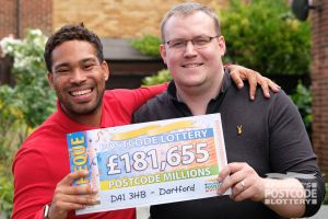 Danyl and David with a Postcode Millions prize cheque