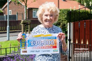 Delighted Worsley winner Joan with her £30,000 windfall