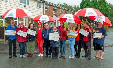 Judie and Danyl celebrating with some of our delighted St. Helens Postcode Millions winners