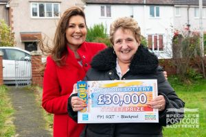 Judie with our Street Prize winner Lesley holding her £30,000 cheque