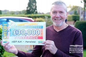 Lucky winner Keith with one of his whopping cheques