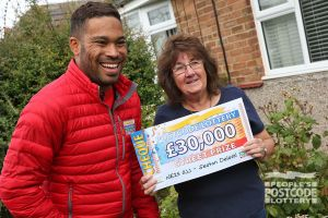 Danyl with happy winner Barbra and her £30,000 cheque