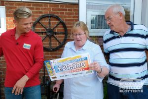 Elaine can't believe her eyes as she holds her cheque worth an incredible £30,000