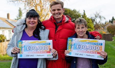 Our delighted Melbourn winners with their lovely cheques and Street Prize Presenter Jeff Brazier