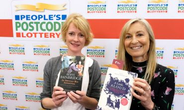 Actor Claire Skinner and our Ambassador Fiona Phillips holding books at a special Shared Reading event in Liverpool