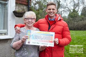 Mary celebrating her £30,000 windfall with Jeff