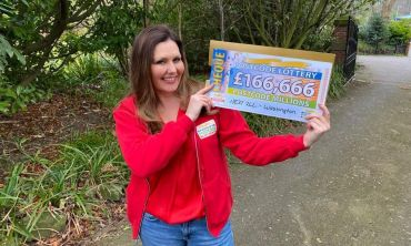 Judie with one of our whopping winner cheques from the Washington Postcode Millions