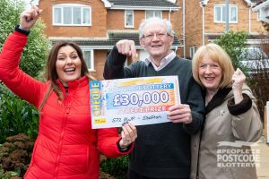 Judie celebrating a £30,000 windfall with Barry and Val