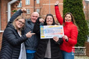 Rachel and her family collecting their Street Prize win