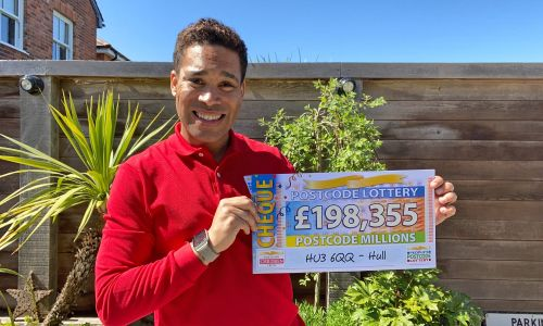 Danyl holds one of the fantastic prizes from our April Postcode Millions draw