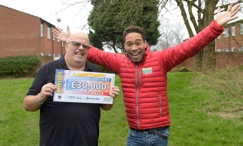 Our happy Brookside winner, David, celebrating with Street Prize Presenter Danyl Johnson