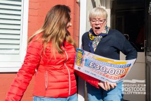 Lucky winner Susan the moment Judie reveals her £30,000 cheque