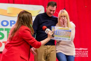 Joanne and husband Huw the moment Judie revealed their big cheque