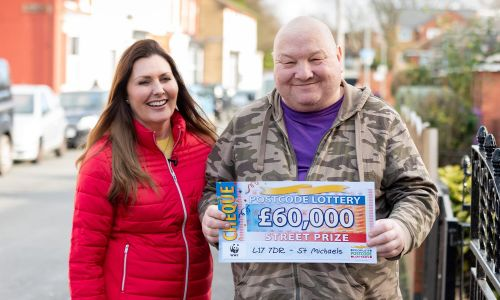 One of our delighted St Michaels winners, Thomas, with his lucky cheque and Street Prize Presenter Judie McCourt