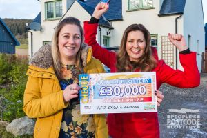 Judie with our winner Lucy holding her £30,000 cheque