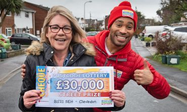 Street Prize Presenter Danyl Johnson celebrating with Catherine, one of our delighted Clevedon winners