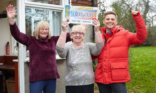 Mary celebrating with her friend Adrienne and Street Prize Presenter Jeff Brazier