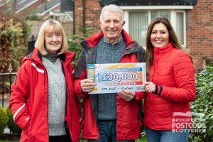 David and Jenny receiving their Street Prize cheque from Judie