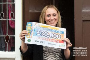 Happy Cheryl plans to use her winnings to help buy a house.