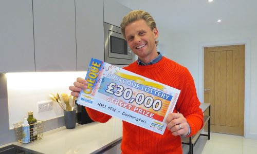 Jeff has a fabulous £30,000 cheque for each of our winners in Dormington