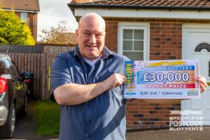 Our winner Neil with his fantastic bolt-from-the-blue £30,000 win
